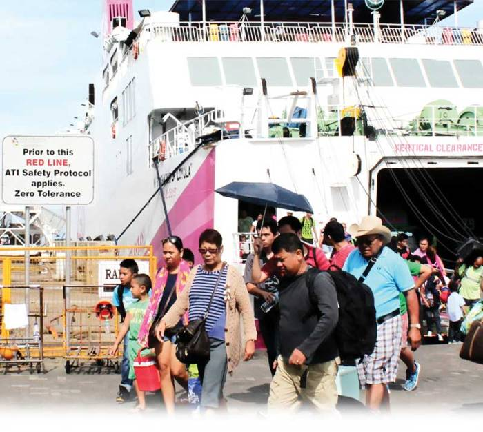 FERRY PASSENGERS disembark ship that sailed from Aklan to the Port of Batangas.